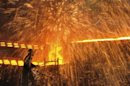 A labourer works at a steel factory in Dalian