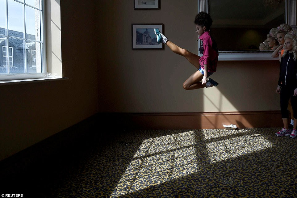 Aibhin Kenneally, 13, from the Flynn-O'Kane dance group warms up backstage before performing during the World Irish Dancing Championships in Dublin, Ireland, on April 11. Next year's competition will be held in Glasgow after beatingBelfast, Dublin and Killarney to host the championships at its Royal Concert Hall