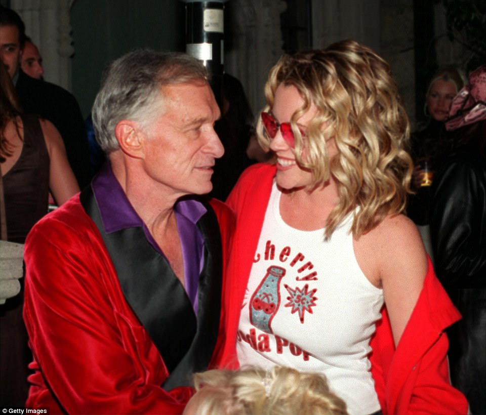 With the dawn of the millennium came a new wave of women for Hefner. By then in his late 70s, he adopted a more grandfatherly demeanor in silk smoking jackets and carried a pipe with him everywhere. He is pictured with actress Jenny McCarthy in 2001
