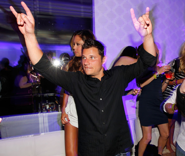 TV personality Vanessa Minnillo and singer/TV personality Nick Lachey attend the Super Skins Kick Off Party at Hotel 944 featuring Snoop Dogg at The Eden Roc Renaissance Miami Beach on February 4, 2010 in Miami Beach, Florida.
