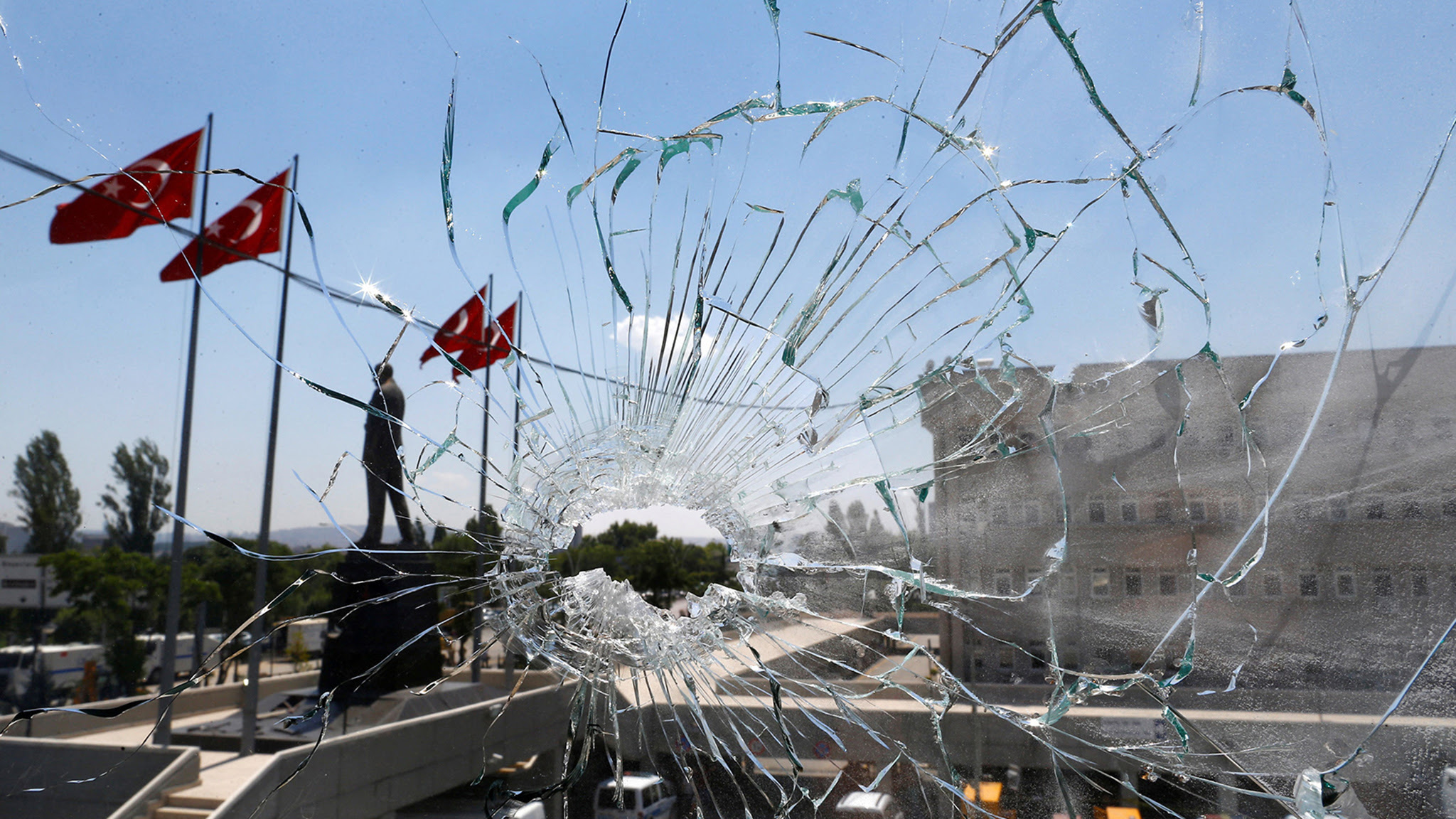 A damaged window is pictured at the police headquarters in Ankara