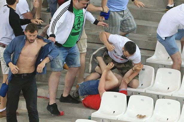 Russian fans attack England fans at the end of the match during the UEFA European Championship 2016 match at the Stade Velodrome