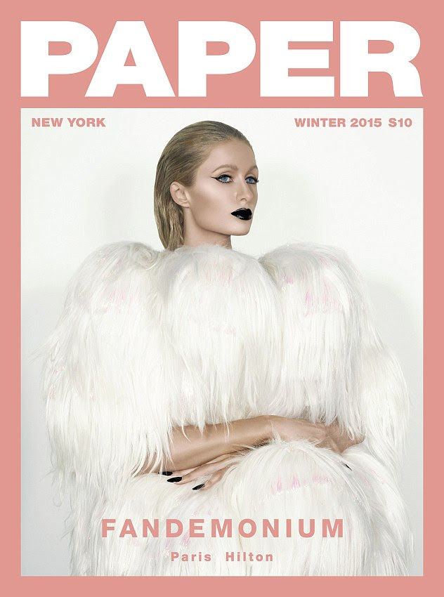 Ice princess: Paris who was also one of the magazine's four cover stars, was photographed in a luxurious-looking white fur coat during her glamorous shoot
