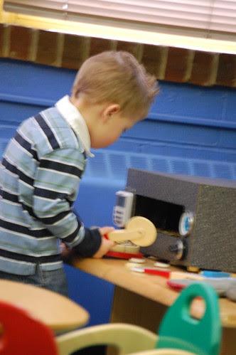 Garrett cooking up pizza