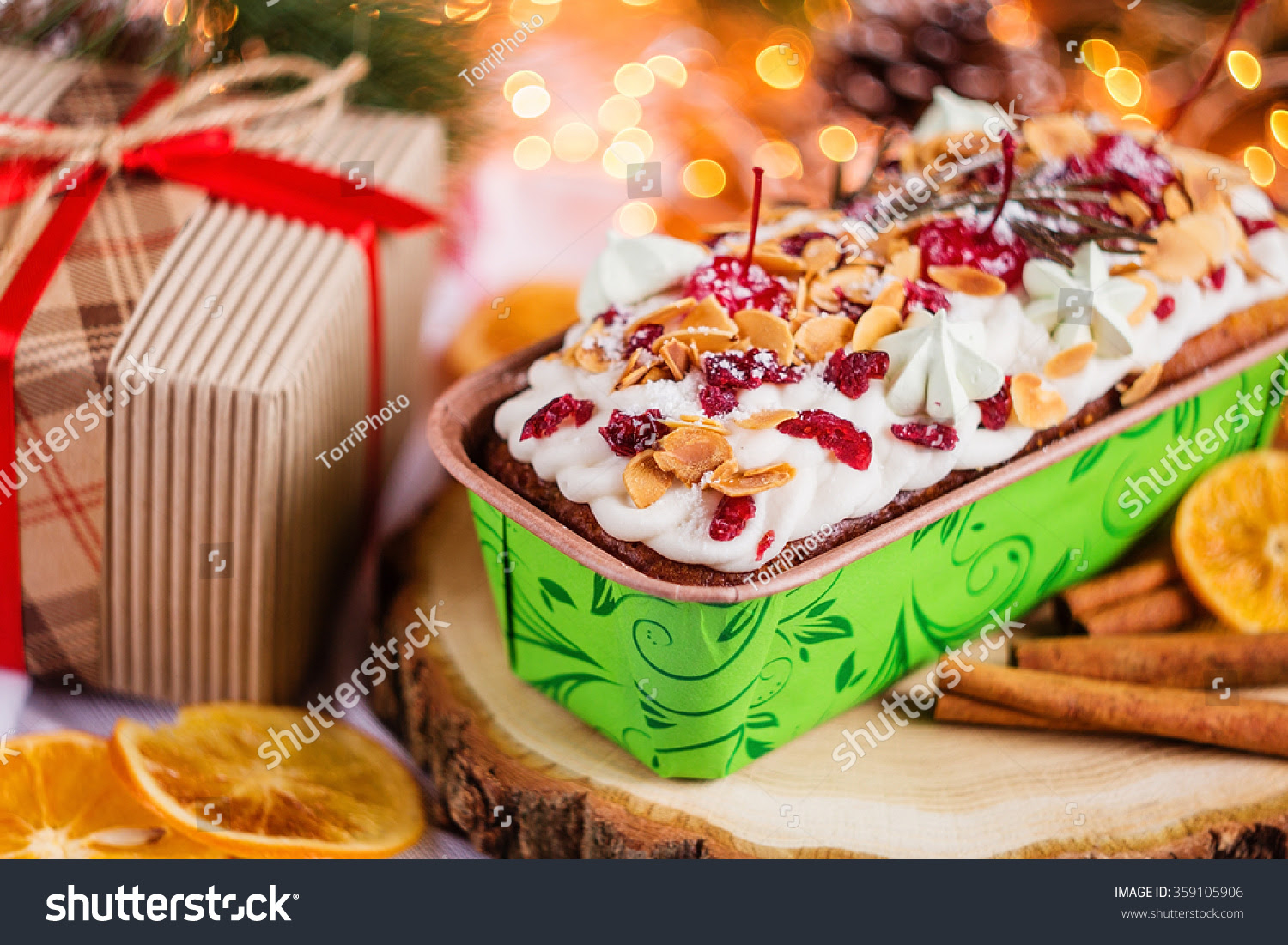 http://www.shutterstock.com/pic-359105906/stock-photo-traditional-christmas-cake-with-holiday-decorations-and-christmas-light-bokeh-background-shallow-focus.html