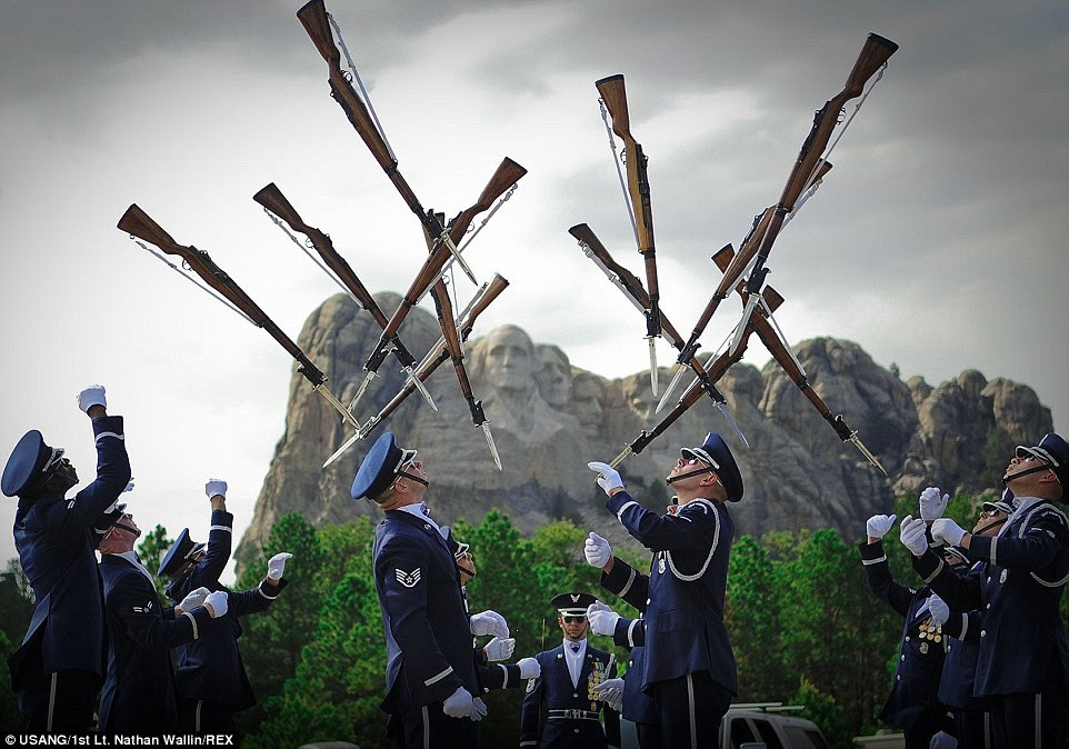 Performance:   The U.S. Air Force Honor Guard Drill Team performs at Mount Rushmore near Keystone, South Dakota. The Drill Team completed a nine-day, seven-city, 10-performance tour across the Midwest with the U.S. Air Force Band's rock ensemble Max Impact