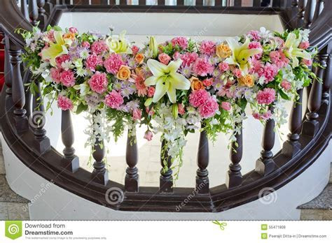 Floral Decorate In Handrail Of Stairs At The Wedding Stock