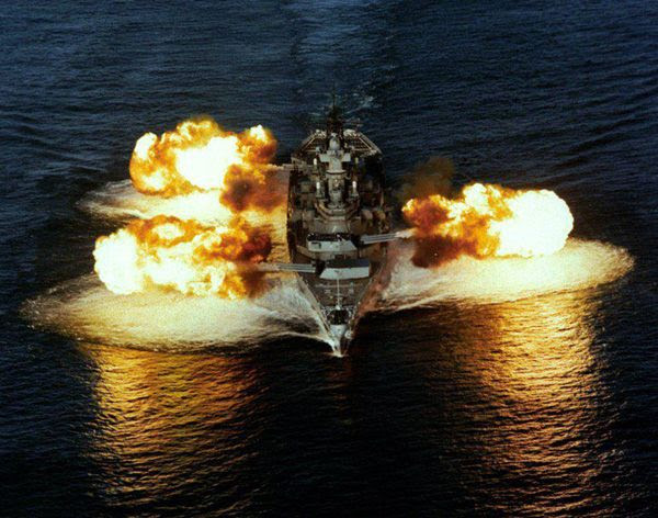 The USS Iowa fires from all three of her 16-inch gun turrets.
