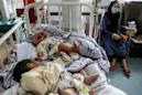 Headscarves and bare hands: women deliver baby during Kabul hospital attack