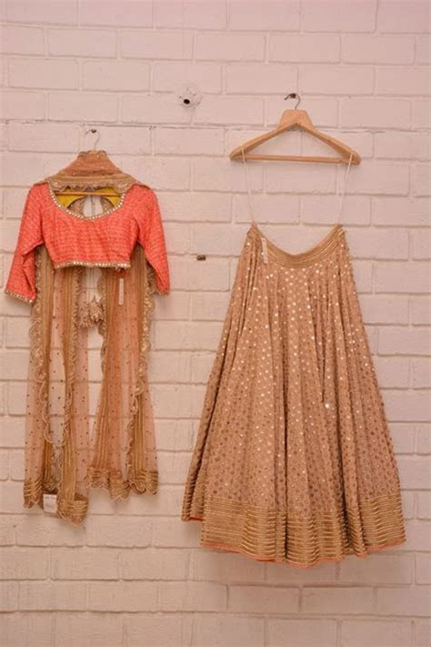 Gold & beige lehenga with coral blouse and scalloped