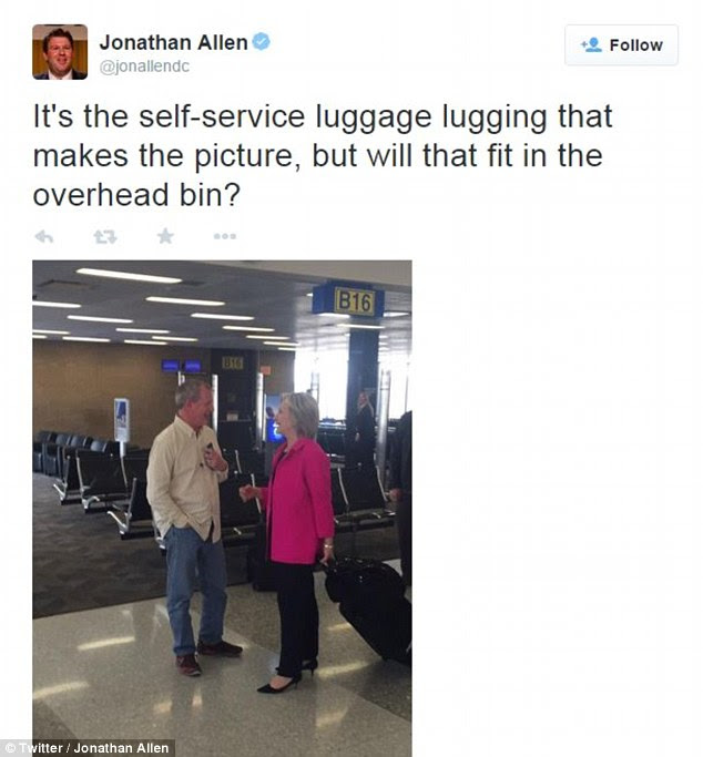 A reporter with the liberal news outlet Vox tweeted a photo of Clinton toting her own luggage on Thursday in Omaha