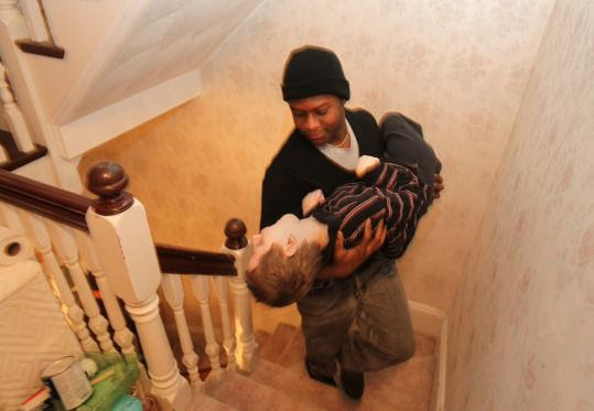 Rudy Favard, 17, cradled Sammy Parker, 8, as he carried him upstairs.