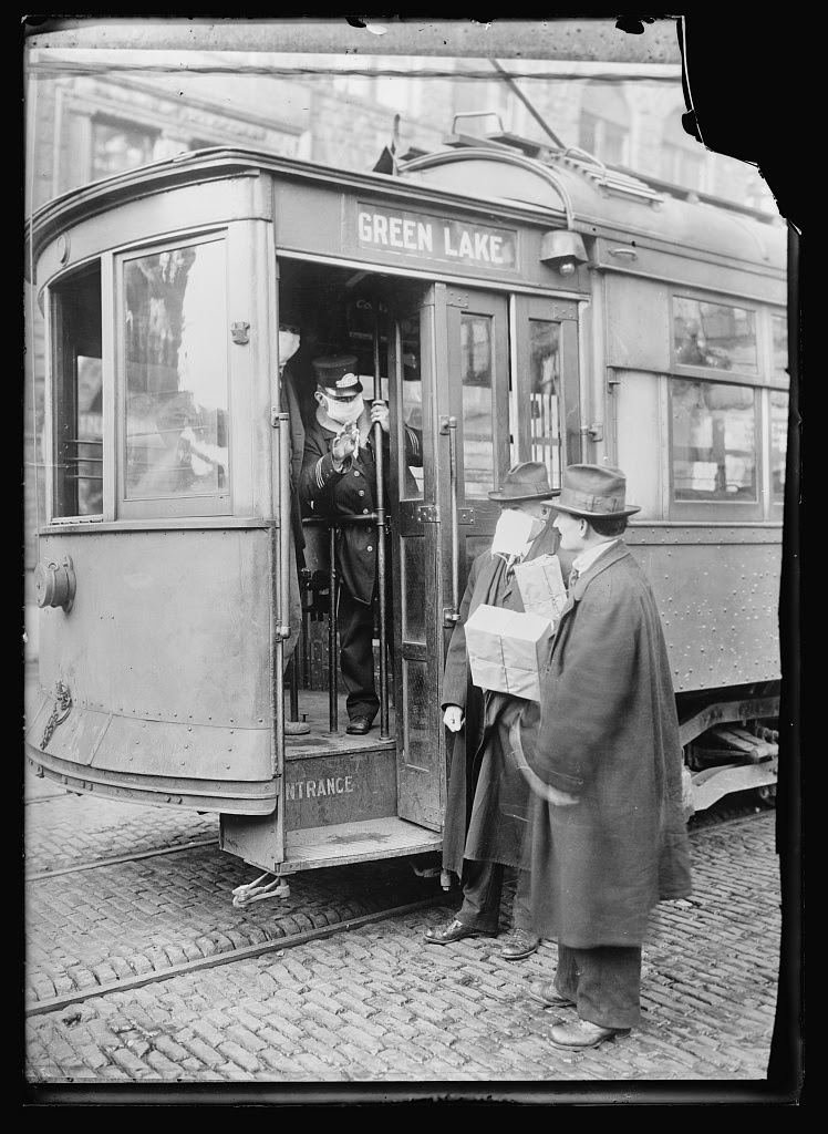 Precautions taken in Seattle, Wash., during the Spanish Influenza Epidemic would not permit anyone to ride on the street cars without wearing a mask. 260,000 of these were made by the Seattle Chapter of the Red Cross which consisted of 120 workers, in three days. Photo from American National Red Cross Collection, circa 1918 or 1919. //hdl.loc.gov/loc.pnp/anrc.02654