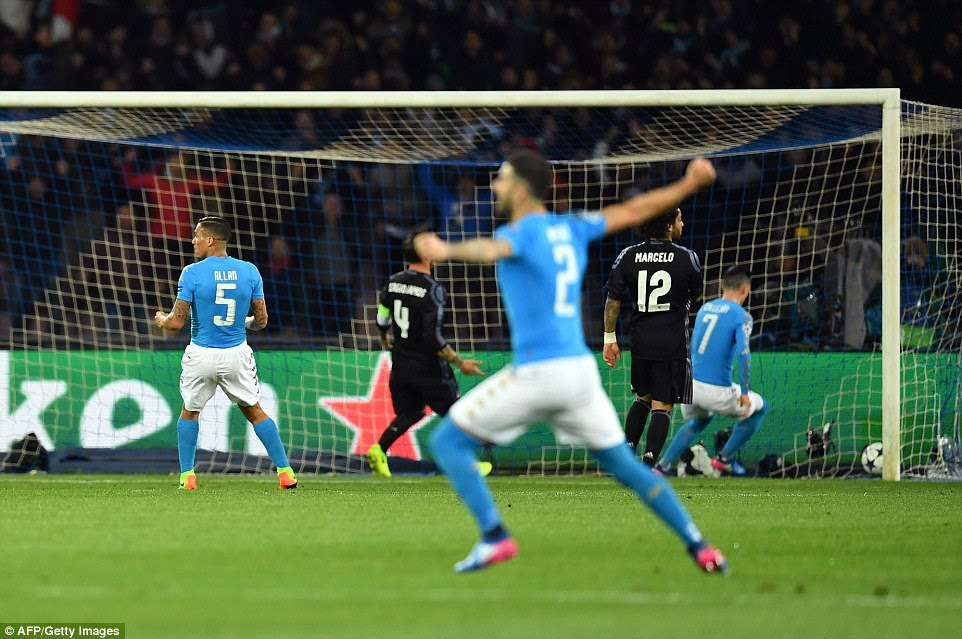 Napoli players celebrate after Mertens beat Keylor Navas with a well-taken low shot into the bottom right corner