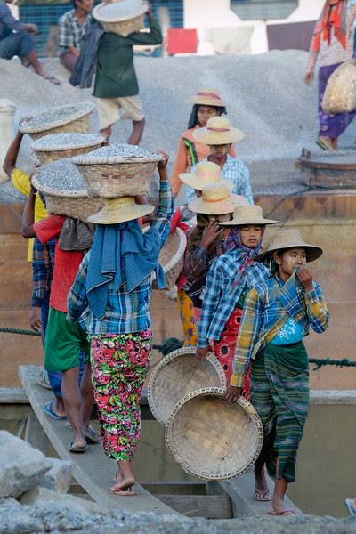 Loading a ship at Ayeyarwadi river, Myanmar