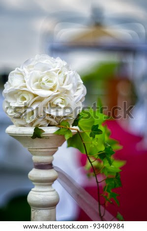 stock photo A floral wedding decoration at red carpet to gazebo