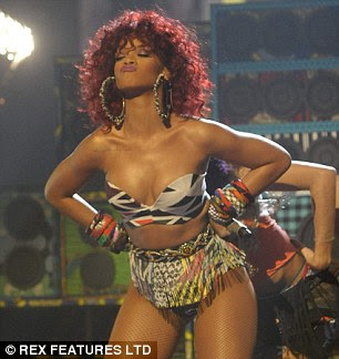 Furore: Over 4,600 viewers complained following Rihanna's risque outfit and dance moves and the racy outfits worn by Christina Aguilera's dancers (right) on the X Factor final last December