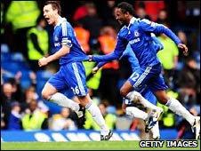 John Terry (l) celebrates his goal with Jon Mikel Obi