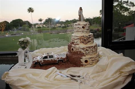 A Redneck Wedding Cake, complete with a 4 wheeler throwing