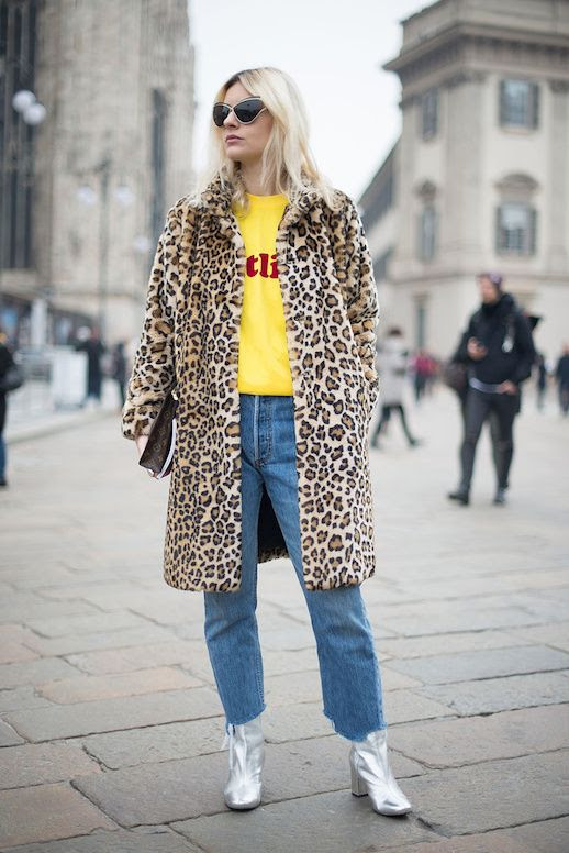 Le Fashion Blog Streetstyle Sunglasses Leopard Coat Yellow Graphic T Shirt Straight Leg Jeans Silver Boots Via Stylecaster
