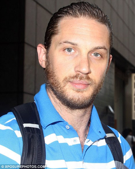 Swept back: Hardy showed off his rather wet look hairstyle as he left his New York hotel today