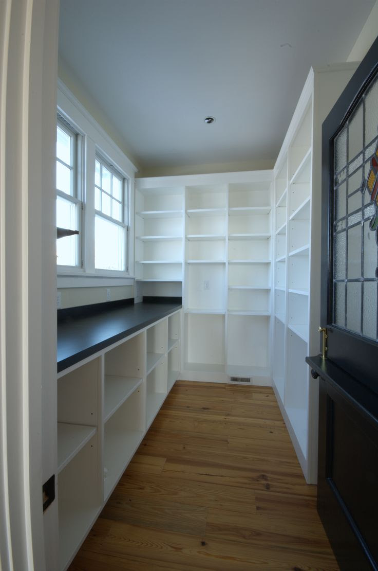 Walk-in pantry -- but no windows please...so I can store my home canned stuff in there. Oh, and also bigger so I can have a couple of deep freezes.