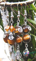 wire wrapped dangle earrings with tiger eyes