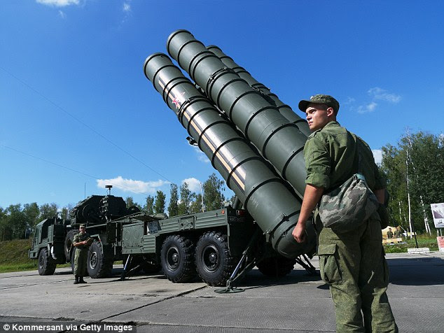 The highly-advanced S-400 Triumph, known by NATO as the SA-21 Growler, pictured, is capable of shooting down an aircraft at a range of 250 miles at an altitude of up to 90,000 feet