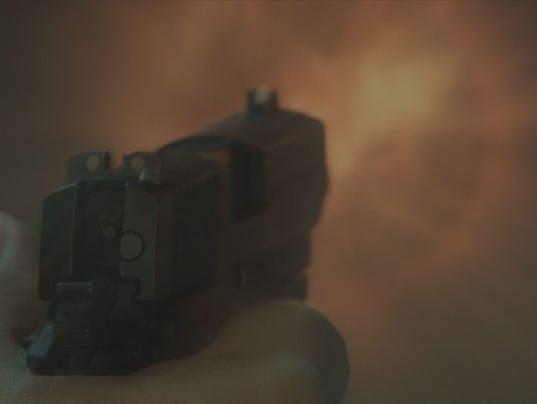 635637875094869144-hand-guns