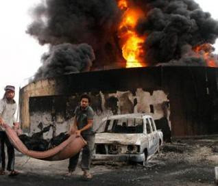 An large explosion hit Sirte on October 25, 2011. This is a bastion of resistance to the US-NATO war against the North African state of Libya. by Pan-African News Wire File Photos