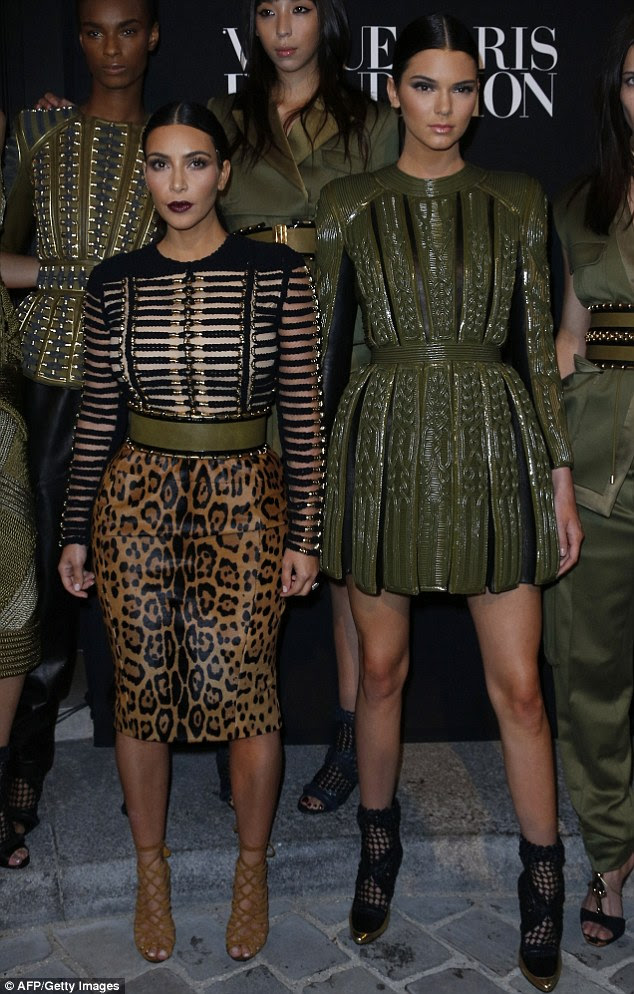 "Fashion family: Kim, standing at 5'3"", and Kendall, at 5'10"", pose at the Vogue Paris Foundation party on July 9"