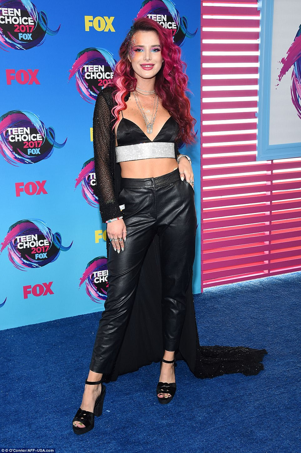 Edgy: Bella Thorne chose black leather for this year's Teen Choice Awards; the former Disney star flashed her stomach in a  glittering crop top with textured trousers