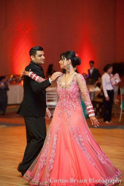 This bride and groom celebrate at their Indian wedding