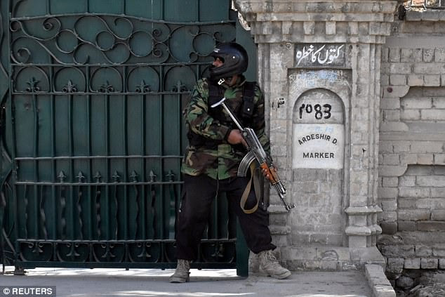 A policeman armed with an automatic weapon took up position outside the church