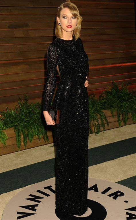 Taylor Swift in long black glittering dress at the Vanity