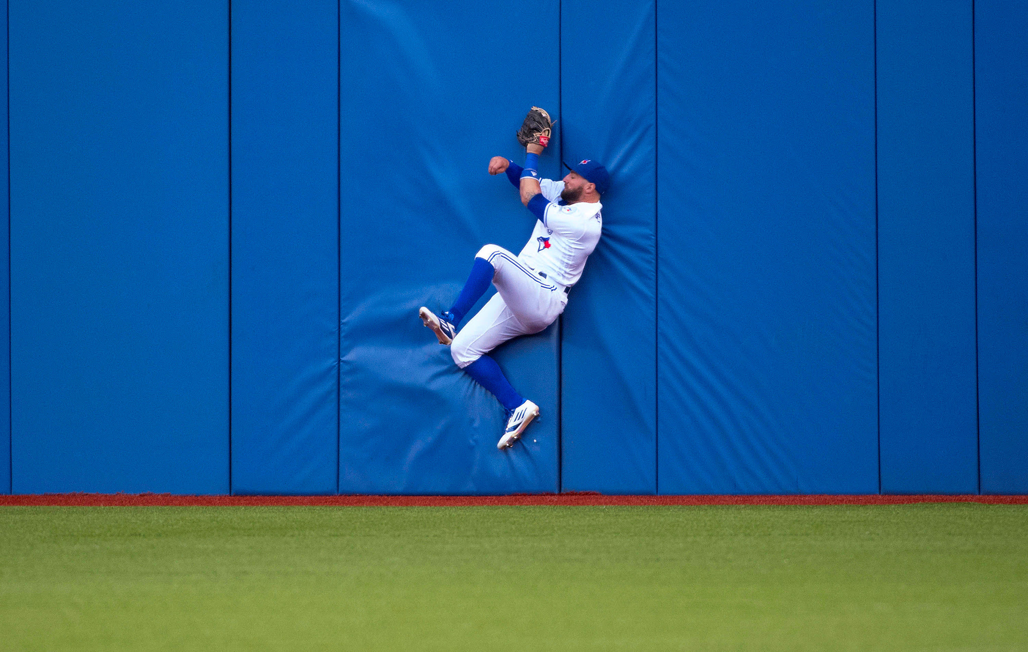 Jun 21, 2016; Toronto, Ontario, CAN; Toronto Blue Jays center fielder Kevin Pillar (11) catches a fly ball for an out during the fourth inning in a game against the Arizona Diamondbacks  at Rogers Centre. Mandatory Credit: Nick Turchiaro-USA TODAY Sport