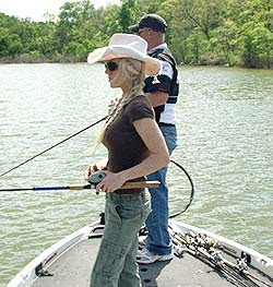 Jen Carroll and Jay Fuller warm up prior to filming a new Wildlife Department show on Lake Texoma smallmouth bass.