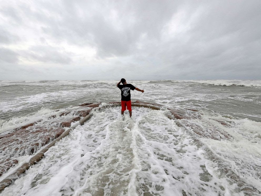 PHOTO: Luis Perez watches waves crash against a jetty in Galveston, Texas as Hurricane Harvey intensifies in the Gulf of Mexico, Aug. 25, 2017.