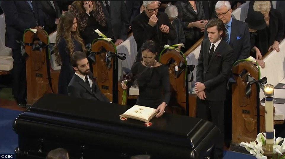 Final farewell: Celine Dion lovingly placed a rose on the casket of her late husbandRené Angélil