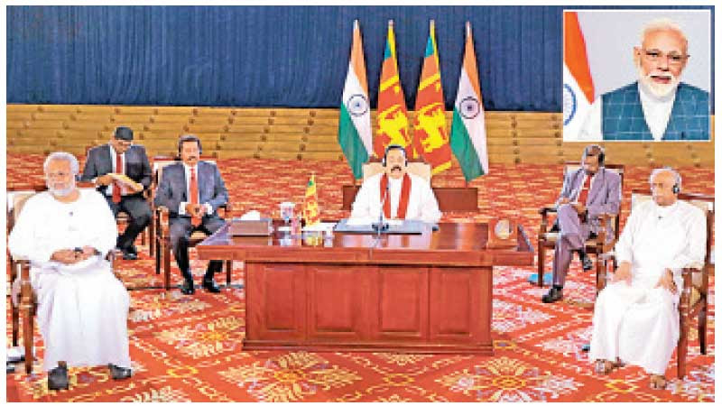Prime Minister Mahinda Rajapaksa at a virtual summit with Indian Prime Minister Narendra Modi along with Ministers Dinesh Gunewardene and Douglas Devananda.