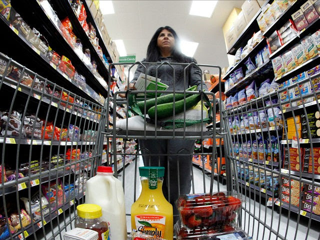 A shopper walks down an aisle in a newly opened Walmart Neighborhood Market in Chicago September 21, 2011. REUTERS/Jim Young