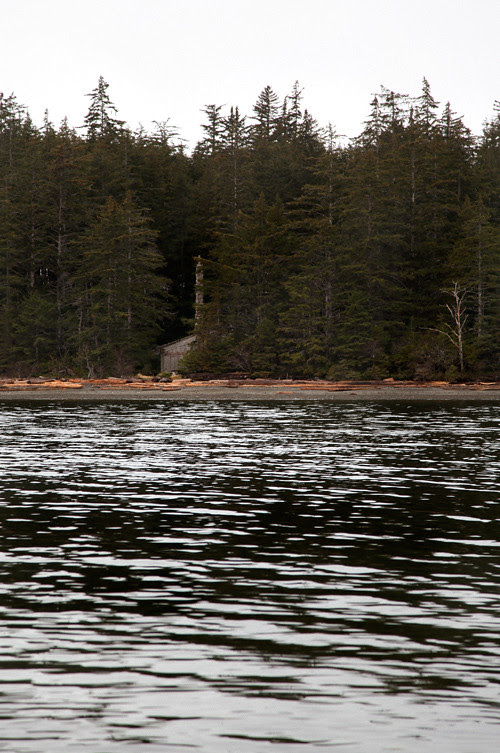 Chief Son-i-Hat Whale House seen from the water at high tide, Kasaan, Alaska