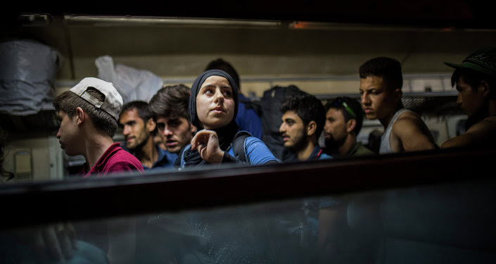 Refugees get off a train at the Macedonian station of Tabanovce, a few hundred meters away from the border with Serbia, on Friday Aug. 28, 2015.