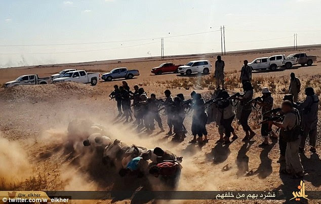 Barbaric: Around 20 ISIS fighters stand behind the line of men and the squad of jihadists begin to murder the prisoners