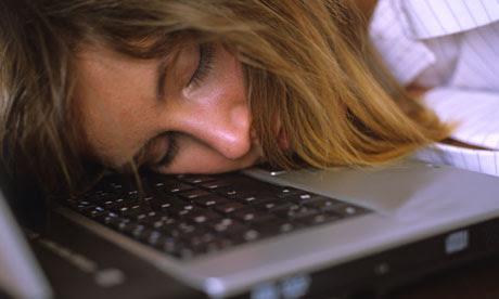 A woman asleep at a computer