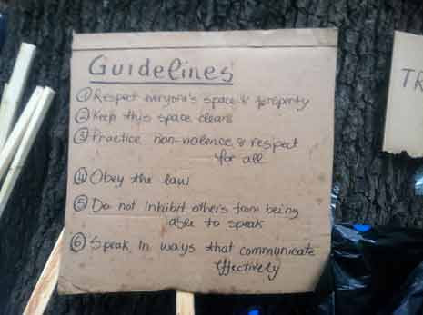 Occupy DC guidelines written on a piece of cardboard