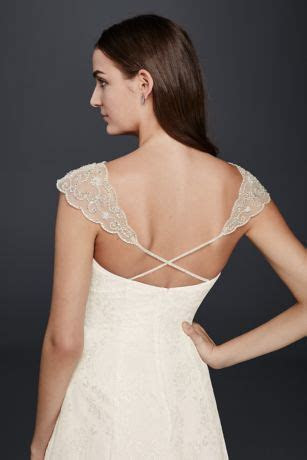 Slip this beaded bridal topper over your strapless wedding