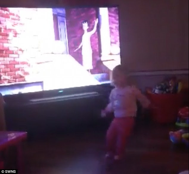 Spooky: The one-year-old is suddenly knocked to the ground, as if being pulled by an unseen force