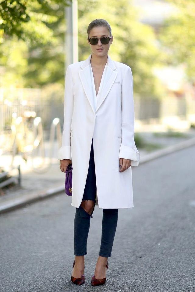 Le Fashion Blog New York Street Style Eleonora Carisi White Coat Ripped Knee Skinny Jeans Burgundy Heels Via Popsugar photo Le-Fashion-Blog-New-York-Street-Style-Eleonora-Carisi-White-Coat-Ripped-Knee-Skinny-Jeans-Burgundy-Heels-Via-Popsugar.png