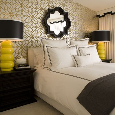 bedrooms - Allen + Roth Quatrefoil Cloche Octagon Mirror black quatrefoil mirror yellow gourd lamps black wood nightstands silver gold metallic geometric wallpaper white bedding black ribbon trim white black cornice box white drapes charcoal gray flannel blanket chic modern hip bedroom